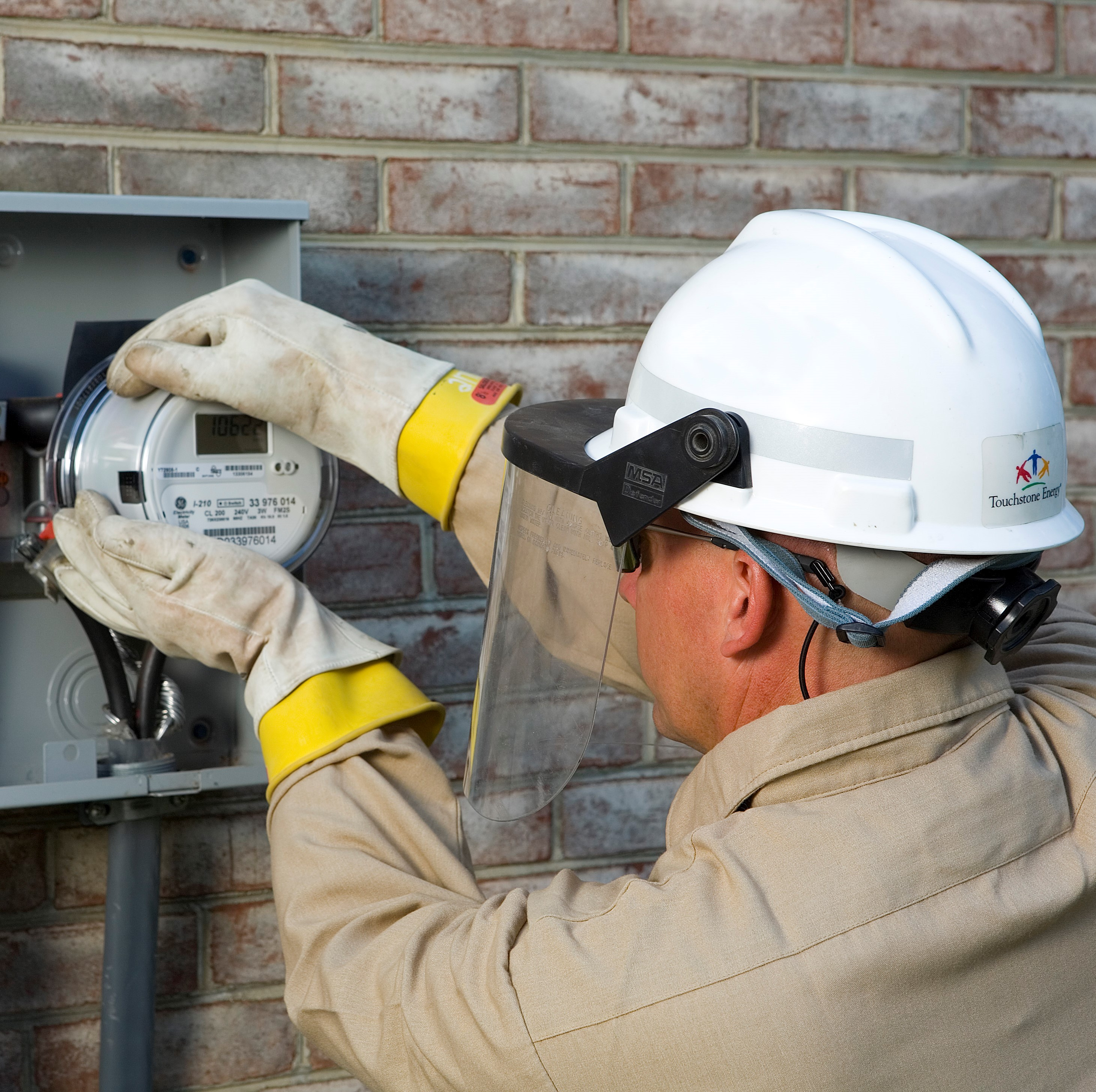 Photo of employee working on a meter.